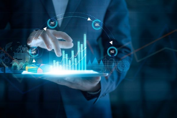 Businessman using tablet analyzing sales data and economic growth graph chart on virtual interface. Business strategy. Abstract icon. Digital marketing.